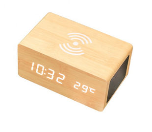 China Three in one Speaker Wireless Charger Wood Clock for Phone Multifunction supplier